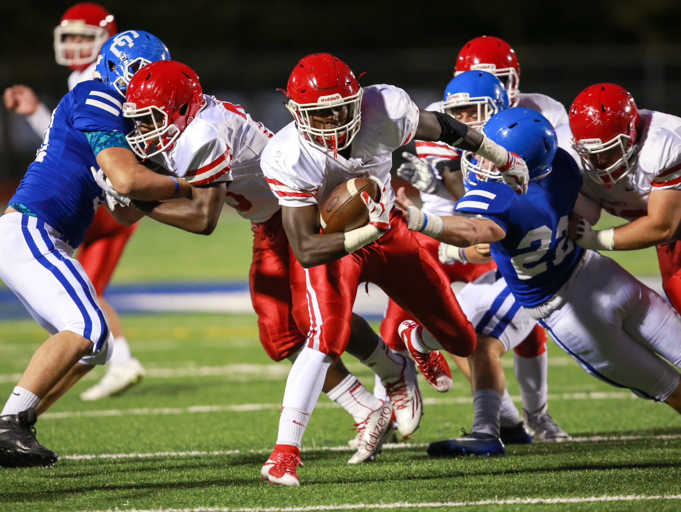 Orchard Lake St. Mary's Justin Myrick breaks though the defensive line against Novi Detroit Catholic Central on Friday.