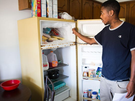 Dominique Sims, a tenant of the building for about a year, said he often has to chip away at the ice in his freezer for the door to close. The landlord has yet to make any repairs, he said.