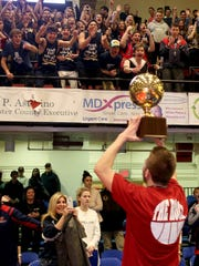 Liam Nowlin of Byram Hills holds the gold ball trophy