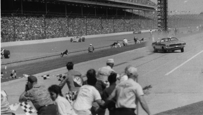 The pace car, driven by car dealer Eldon Palmer, loses control shortly before crashing into the photographers stand at the Indianapolis 500 in May 1971.