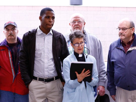 Pavion Phillips stands next to Rev. Laurie Bushbaum while she speaks Wednesday at the Marathon County Courthouse in Wausau. Bushbaum serves as the minister at the First Universalist Unitarian Church in Wausau. Behind them are advocates Brian Mach, left, Ron Alexander, and Ted Sperduto.