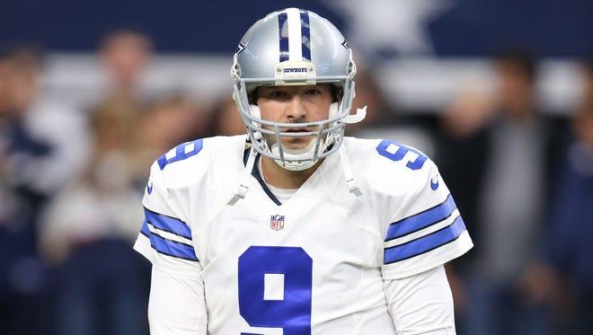 Dallas Cowboys quarterback Tony Romo (9) stretches prior to the game against the Baltimore Ravens at AT&T Stadium.