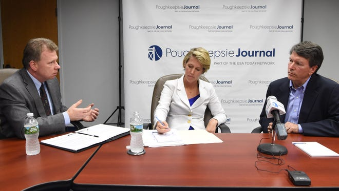 Opinion and Engagement Editor John Penney, left, speaks with congressional candidates Zephyr Teachout, center, and John Faso, right.