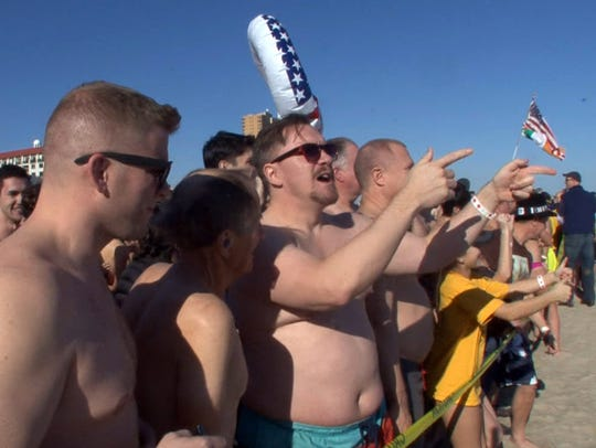Polar Bear plungers get ready to hit the surf just
