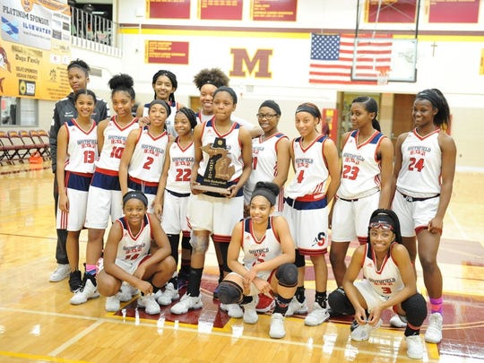 The Southfield Arts & Technology girls basketball team celebrates after winning a Class A district championship Friday against Farmington Hills Mercy.