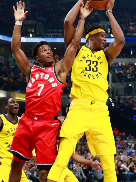 Toronto Raptors guard Kyle Lowry (7) tries to take the basketball from Indiana Pacers center Myles Turner during the first half of an NBA basketball game, Friday, Nov. 24, 2017, in Indianapolis. (AP Photo/R Brent Smith)