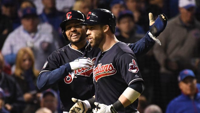 Coco Crisp (left) celebrates with Jason Kipnis after Kipnis hit a three-run home run in the seventh inning.