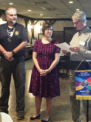 Amanda Rammer (assistant VP, BMO Harris) being inducted into the Early Bird Sheboygan Rotary Club by President Greg O'Neal as Scott Morrelle, her sponsor looks on.