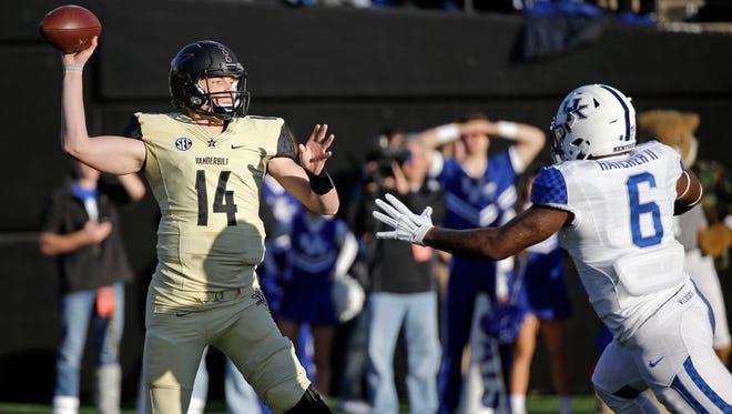 Vanderbilt quarterback Kyle Shurmur (14) passes as he is pressured by Kentucky defensive end Jason Hatcher (6) in the first half of an NCAA college football game Saturday, Nov. 14, 2015, in Nashville, Tenn.