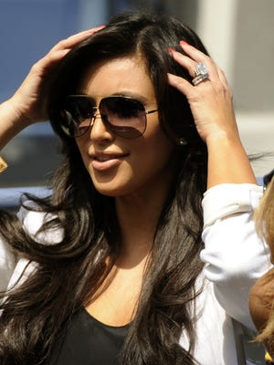 Kim Kardashian did some heavy lifting back in 2011 when she was (briefly) a married lady.