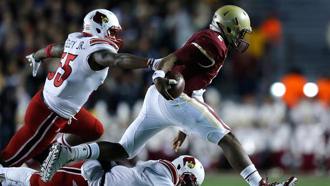CHESTNUT HILL, MA - NOVEMBER 8: Keith Kelsey #55 and Charles Gaines #3 of the Louisville Cardinal chase Tyler Murphy #2 of the Boston College Eagles in the second quarter at Alumni Stadium on November 8, 2014 in Chestnut Hill, Massachusetts. (Photo by Jim Rogash/Getty Images)