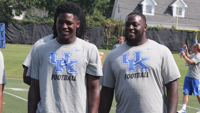 UK linebackers Eli Brown (left) and Jabari Johnson (right) watch drills during an event with the Special Olympics during preseason camp in 2015.