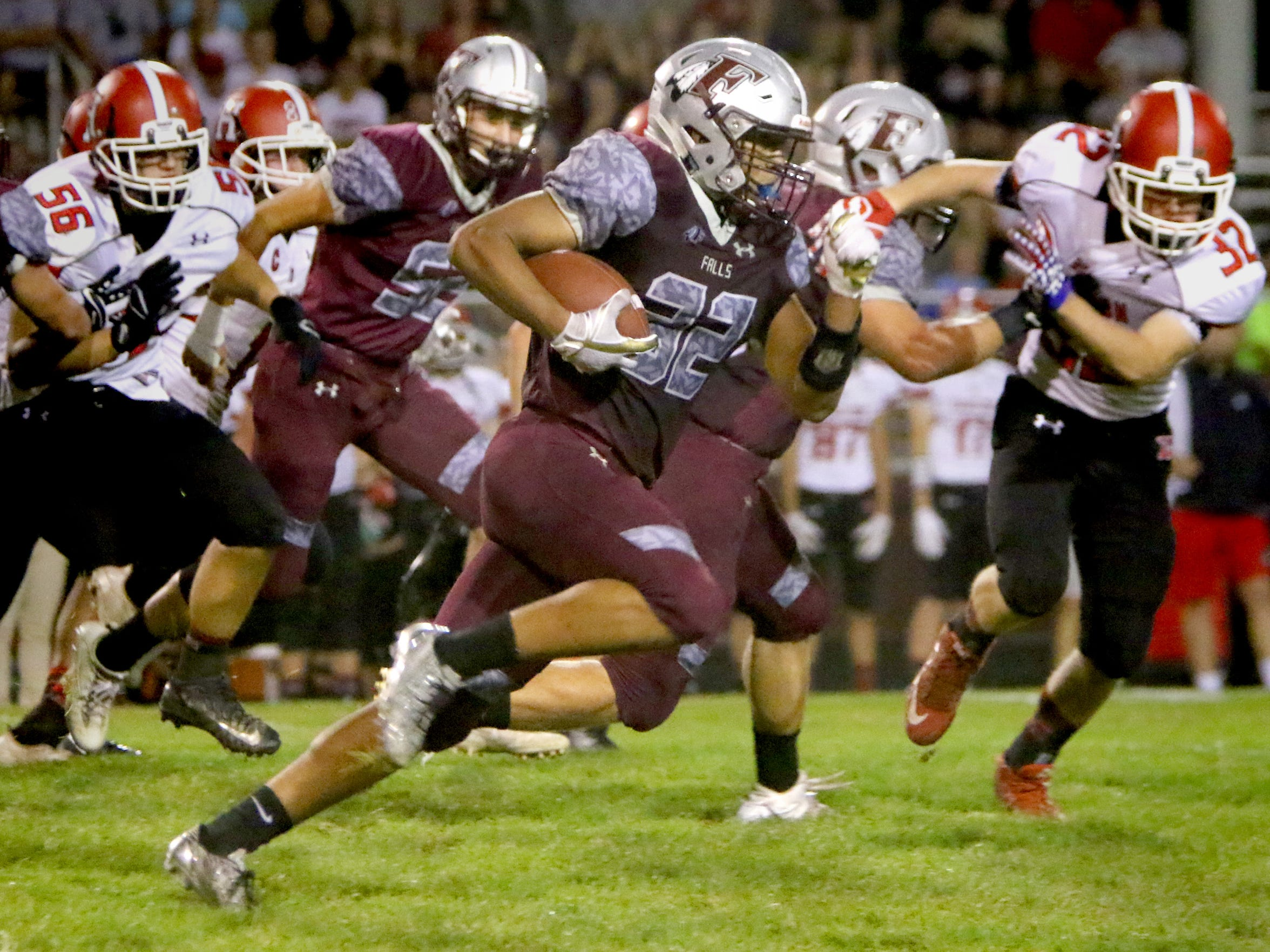 Menomonee Falls' Julius Davis breaks away from Sussex Hamilton defenders for a touchdown at home on Sept. 25.