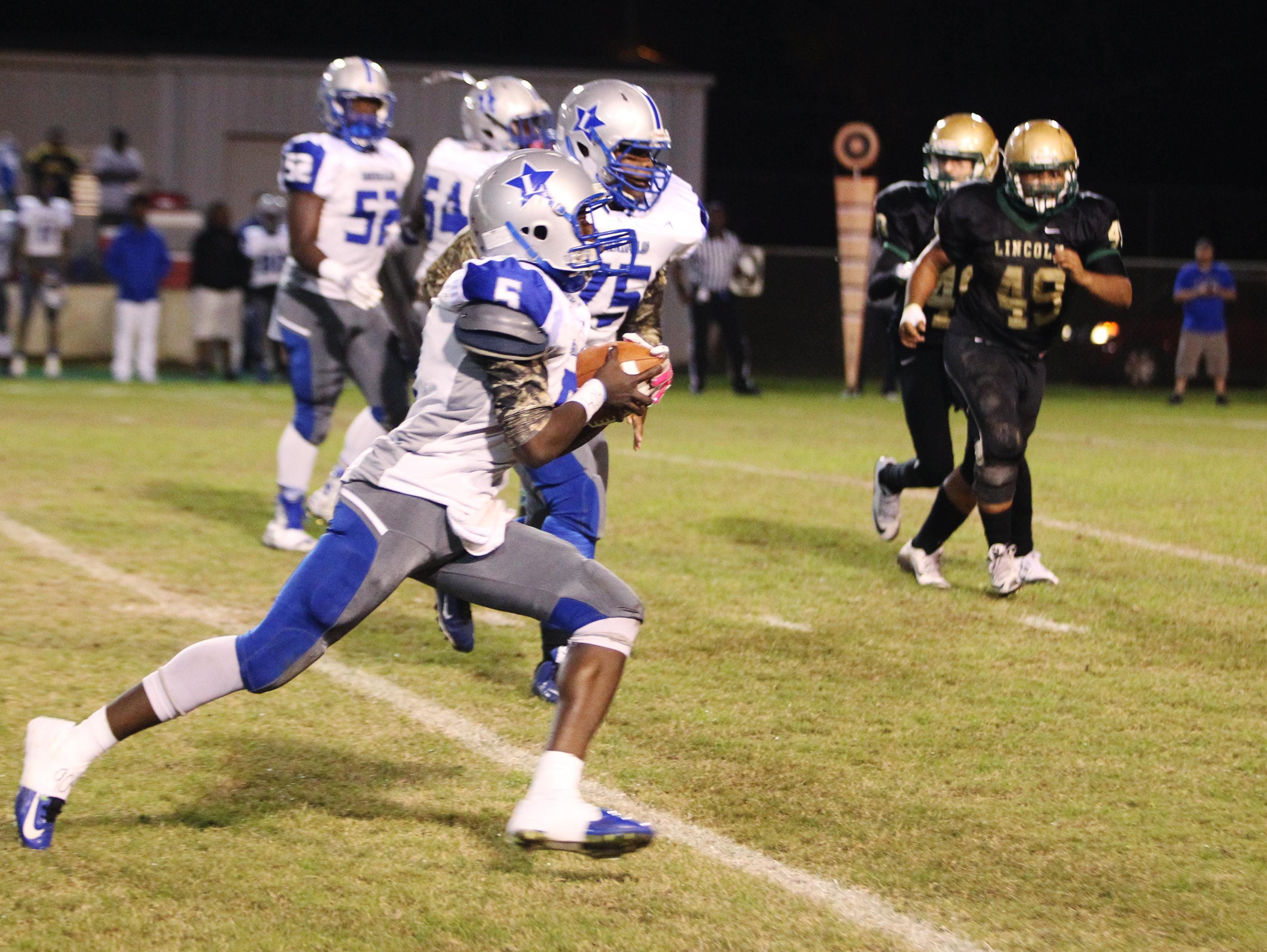 Lee's Derrick Jones rushed for 167 yards and three touchdowns and threw for 140 yards and a score, but he also threw two costly interceptions as Lincoln won 44-41 in overtime.