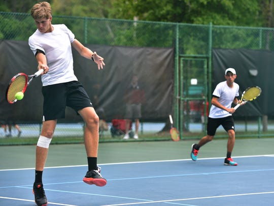Colter DeCoste (left) and Avery Davis, of Jensen Beach High School. return a shot against Barron Collier during a doubles match in the FHSAA Class 3A Tennis State Championship April 14, 2016 at Sanlando Park in Altamonte Springs. Jensen Beach won 6-3, 6-1.