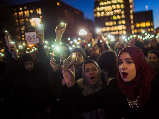 Muslim women shout slogans during a rally against President Donald Trump's order cracking down on immigrants living in the U.S. at Washington Square Park in New York, Wednesday, Jan. 25, 2017.