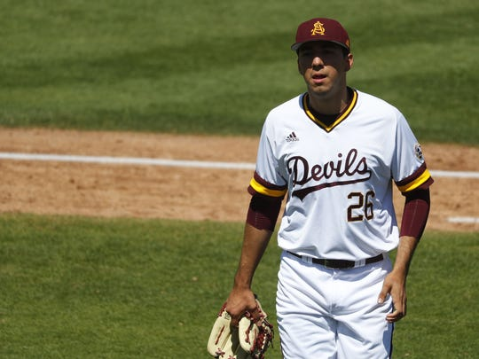 ASU's Sam Romero (26) comes off the mound after giving