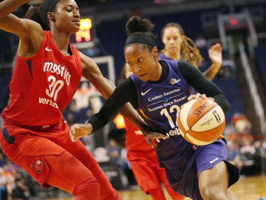 Phoenix Mercury guard Briann January (12) drives against