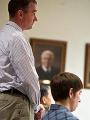 Left, Code Enforcement Director Bill Ward appears in