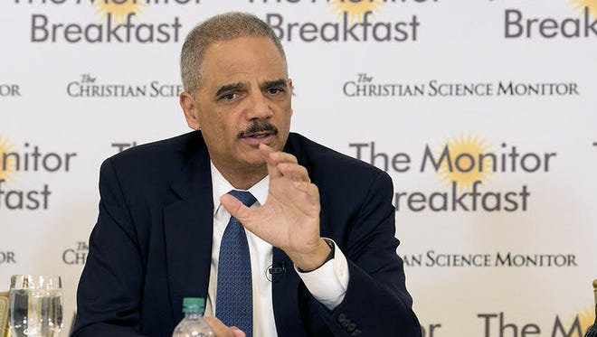 Former Attorney General Eric Holder talks to reporters at the Christian Science Monitor breakfast Wednesday about efforts to address redistricting concerns.