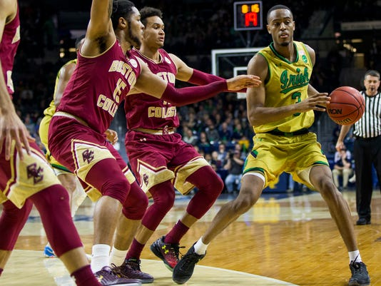 Notre Dame's V.J. Beachem (3) gets pressure from Boston College's MoJeffers (15) and A.J.Turner, center, during the first half of an NCAA college basketball game Wednesday, March 1, 2017, in South Bend, Ind. (AP Photo/Robert Franklin)