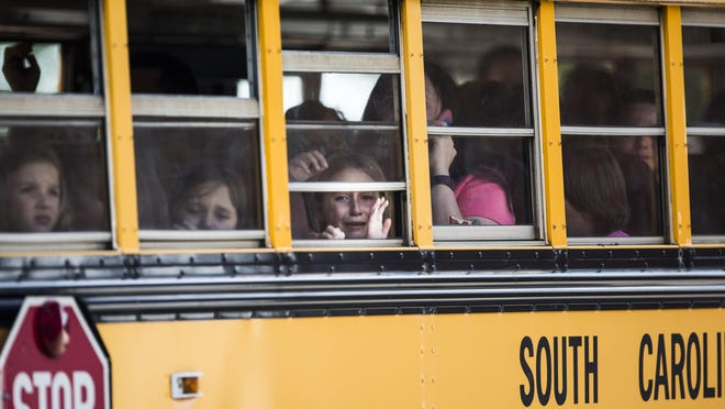 A student weeps after a deadly shooting at Townville Elementary School in September. In the wake of the incident, some state lawmakers have introduced bills that would allow educators to carry guns on campus, but many Upstate educators oppose the idea.