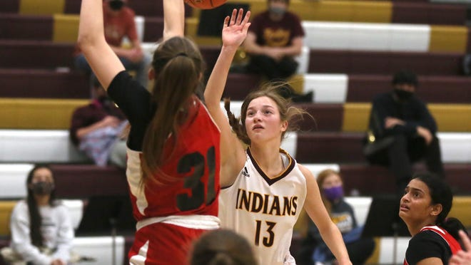Hays High's Carly Lang puts up a shot that is blocked by Life Prep's Aleksandra Duda on Friday at HHS.