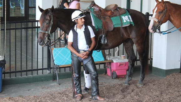 Horse trainer awaiting next race.