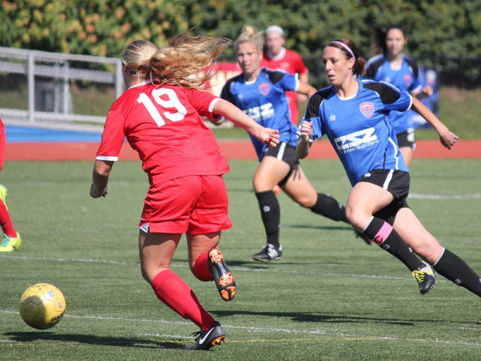 Lady Saints co-captain Kim Comisar-Granell goes for the ball at midfield in the July 5 game against FC Pride