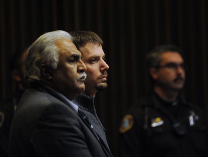Flanked by his attorney Azhar Sheikh, left, and sheriff's