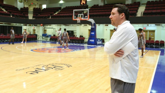 Stepinac basketball coach Pat Massaroni, right, runs