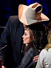 Alan Jackson hugs Loretta Lynn during this induction