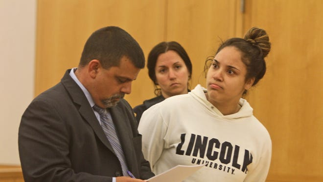 Nadia Figueroa, 23, of the Bronx, reacts as she listens to the prosecutor make a case for $50,000 bail during her arraignment in Westchester County Court Sept. 16, 2014. Figueroa was among three people charged in connection with an identity-theft ring targeting bank customers across Westchester and Orange counties