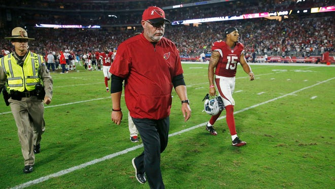 Arizona Cardinals head coach Bruce Arians walks off the field after a 23-21 loss to the New England Patriots on Sept. 11, 2016.