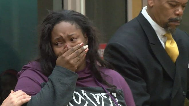 Kayla Wilson cries in court Wednesday as she is led away.