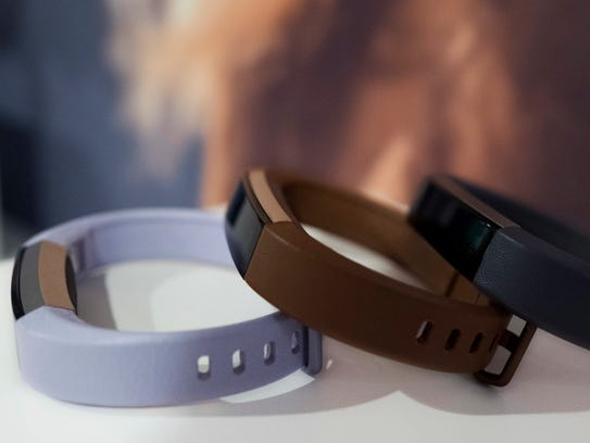 Fitbit's new Alta HR is shown in several colors.