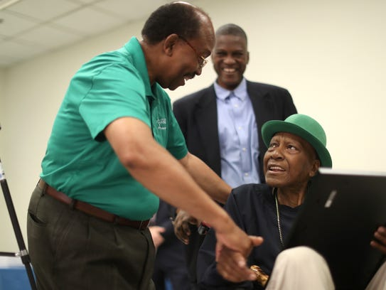 City Commissioner Curtis Richardson shakes the hand