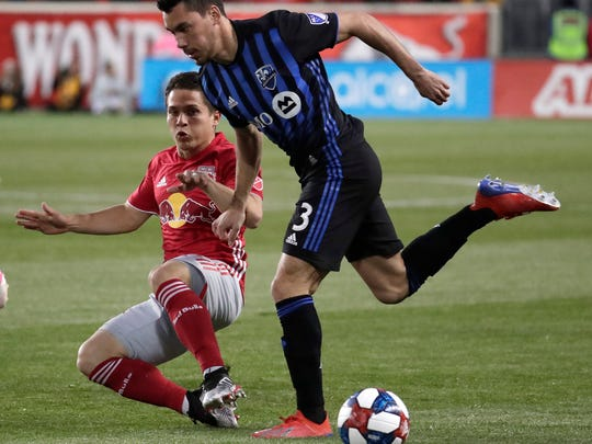 Montreal Impact defender Daniel Lovitz, right, drives against New York Red Bulls defender Connor Lade during the first half of an MLS soccer match Wednesday, May 8, 2019, in Harrison, N.J. (AP Photo/Julio Cortez)
