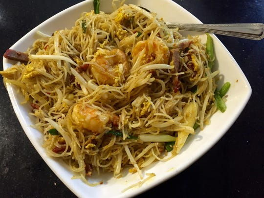 At Golden Flower, a fragrant snarl of Singapore noodles arrives loaded with shrimp and char siu.