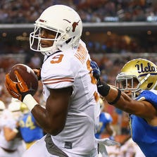 ARLINGTON, TX - SEPTEMBER 13:  John Harris #9 of the Texas Longhorns makes a touchdown pass reception against Adarius Pickett #8 of the UCLA Bruins in the fourth quarter at AT&T Stadium on September 13, 2014 in Arlington, Texas.  (Photo by Ronald Martinez/Getty Images)