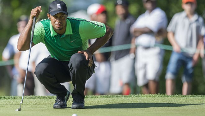 Tiger Woods lines up his putt during the first round of the Quicken Loans National at Congressional Country Club. Woods shot 39 on his first nine.