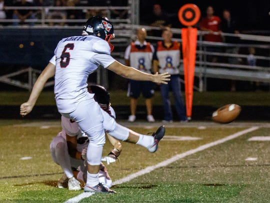 Muskego kicker Lucas Amaya (6) kicks a PAT during the