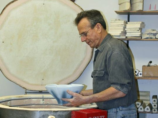 Local potter Alan Newman is preparing porcelain pottery for the Salem Art Fair and Festival.