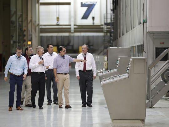Gov. Scott Walker takes a plant tour before the announcement