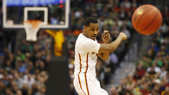 Iowa State guard Monte Morris (11) passes the ball around Iona Thursday during the Cyclones' first-round win.