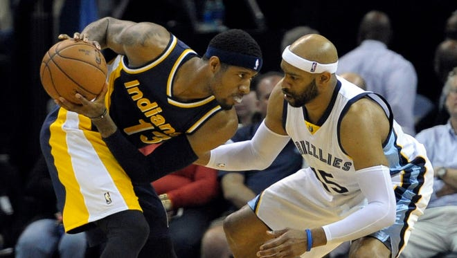 Indiana Pacers forward Paul George (13) handles the ball against Memphis Grizzlies guard Vince Carter (15) during the game at FedExForum. Memphis Grizzlies beat Indiana Pacers 95-83.
