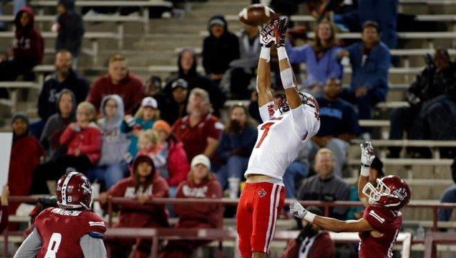 UL receiver Jared Johnson goes high for a 2014 touchdown catch against New Mexico State.