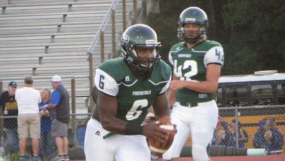 Holmes (6) playing QB as a senior at Pontchatoula but