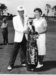 Golf pro Ed Caldwell poses with professional golfer Marilynn Smith at the Cape Coral golf course in the 1960s.