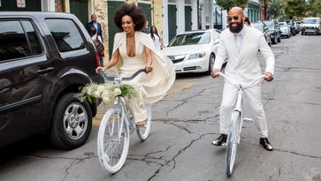 Solange Knowles (wearing a pre-ceremony ensemble by Stephane Rolland) and her fiance Alan Ferguson, ride bicycles in French Quarter en route to their wedding Nov. 16, 2014 in New Orleans.